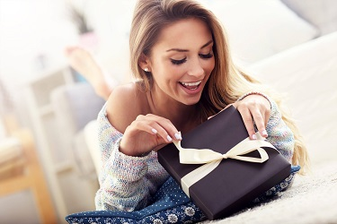 Excited girl is opening her gift